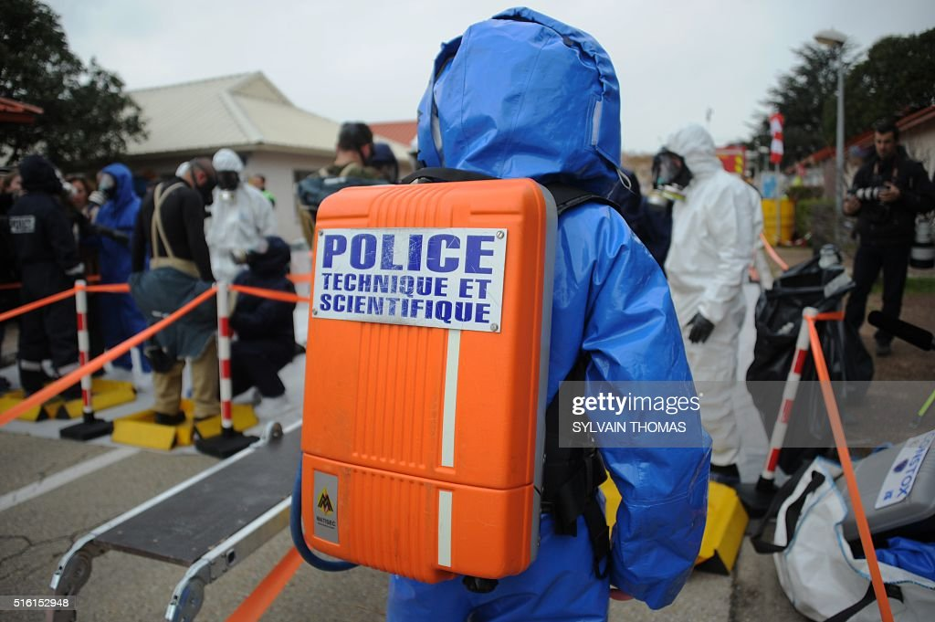 A French forensic investigator takes part in a simulation of terrorist attack in football fanzone in Nimes on March 17 2016 as part of Euro 2016 The...