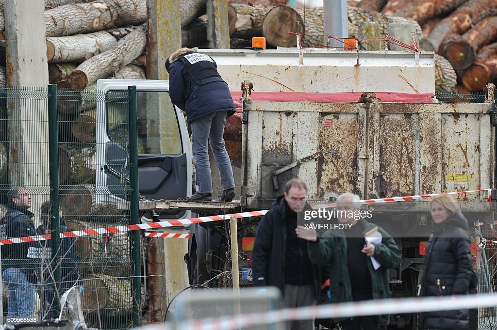 French forensic police officer work near the wreckage of a truck after it crashed into a school minibus in Rochefort on February 11, 2016, killing at least six children, police said, a day after another road accident involving a school bus left two youngsters dead. The head-on smash with a lorry carrying rubble came around 7:15 am (0615 GMT) in Rochefort in the western Charente-Maritime region. The school bus was carrying about 17 people, and three children suffered minor injuries in the accident, a police source said. / AFP / XAVIER LEOTY
