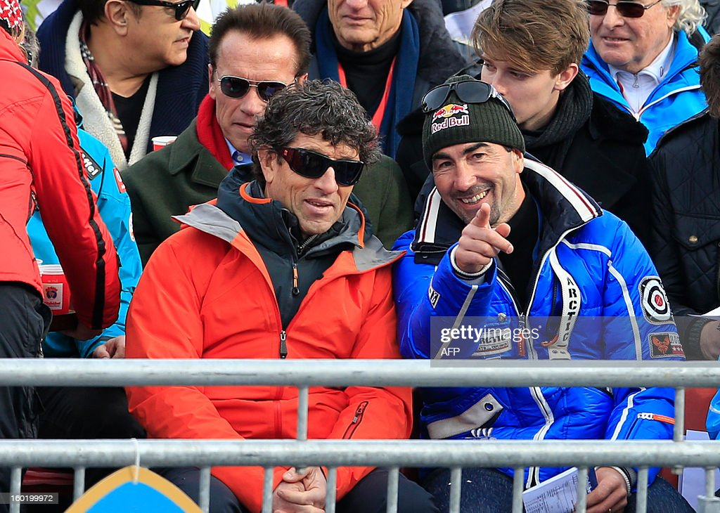 French former alpine skier and race car driver Luc Alphand (R) gestures as he attends the FIS World Cup men's slalom race on January 27, 2013 in Kitzbuehel, Austrian Alps.