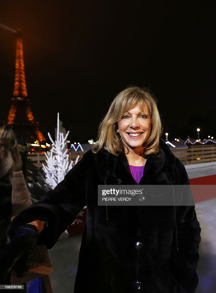 French former backstroke swimmer Christine Caron (aka 'Kiki' Caron) poses in the 'Christmas village' during its inauguration on December 13, 2012, in Paris, as part of the 'Trocadero On Ice' event. An ice-skating rink opened to public in front of the Eiffel tower, and will run until January 6, 2013.
