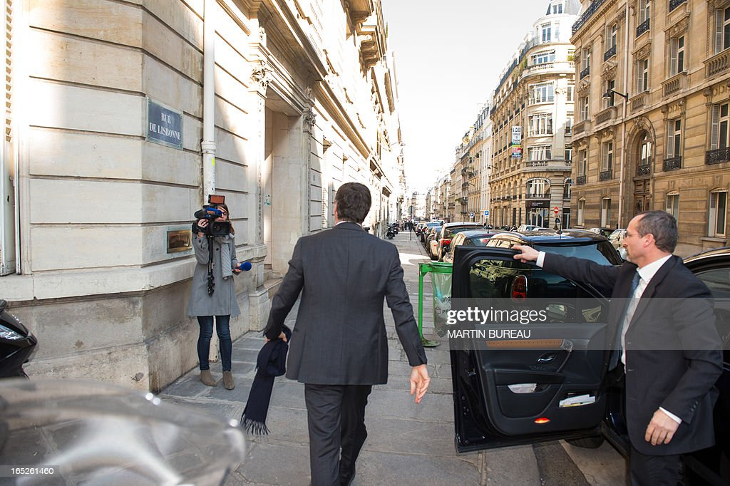 French former Budget minister Jerome Cahuzac (C) arrives at the financial pole in Paris, on April 2, 2013. Cahuzac, who resigned on March 19, was being heard by investigating judges on April 2, 2013 as part of a probe into a Swiss bank account he allegedly used to hide assets from the tax authorities. Cahuzac admitted to have a foreign account amid tax probe.
