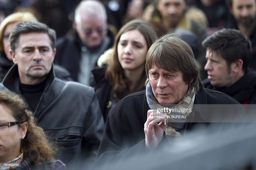 French former CGT union General secretary Bernard Thibault leaves after the funeral ceremony of French cartoonist and Charlie Hebdo editor Stephane...