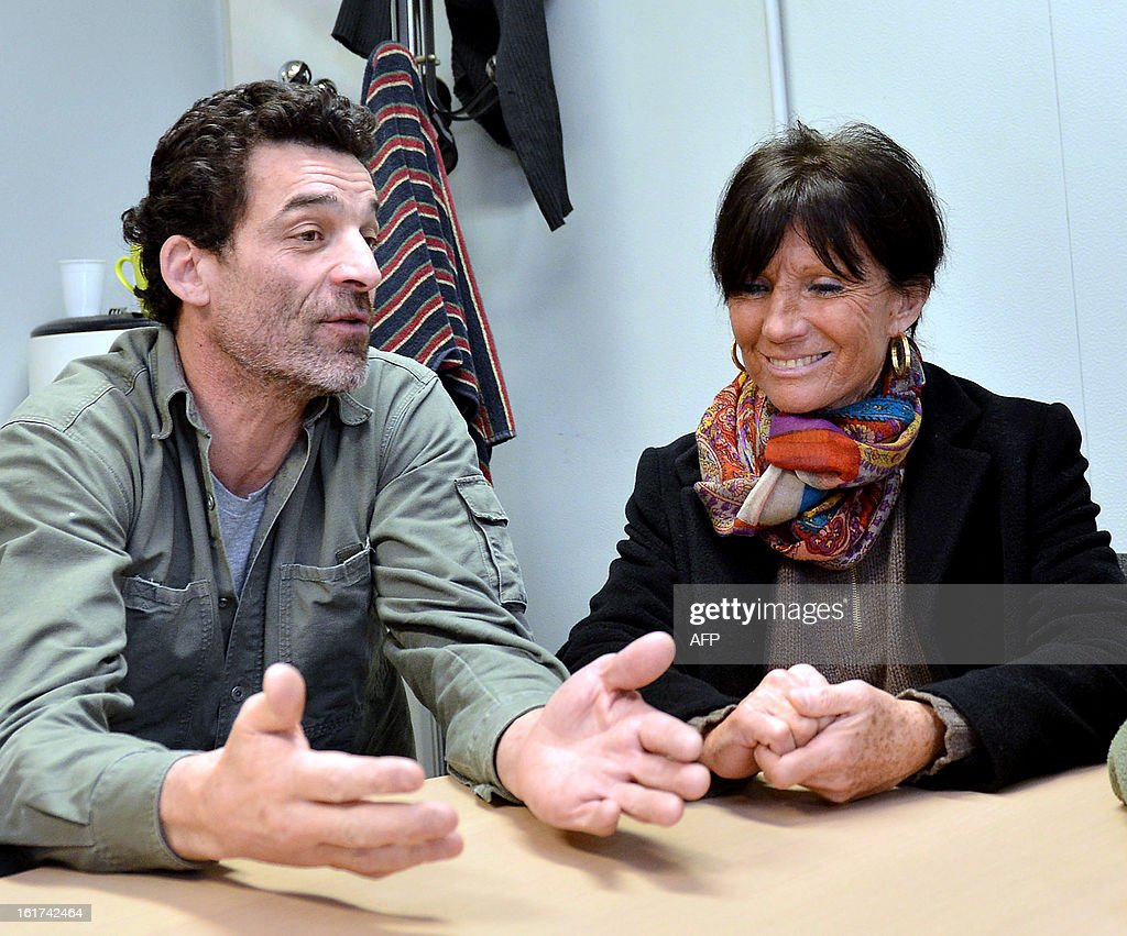French former CGT union representative at German auto parts maker Continental Clairvoix factory, Xavier Mathieu (L) next to Marie laure Dufresnes-Castets, lawyer of struggle committee (R) gives a press conference, on February 15, 2013, in Clairoix. Administrative Court annulled on February 14, 2013, the decisions Amiens on dismissal of employees protected plant Continental Clairoix, which challenged the economic motive. AFP PHOTO RICHARD DUGOVIC