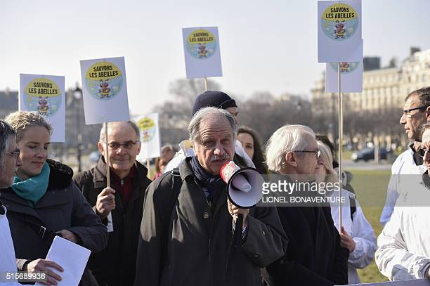 French former Ecology minister Delphine Batho and French MP from the Ecologist group Noel Mamere speak beside beekeepers on March 15 2016 in Paris...