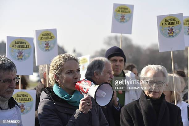 French former Ecology minister Delphine Batho speaks beside beekeepers on March 15 2016 in Paris during a demonstration against the use of...