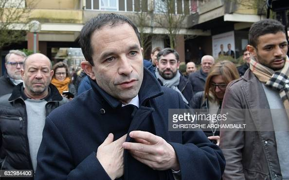 French former education minister and candidate for the leftwing primaries Benoit Hamon leaves a polling station after voting in the second round of...