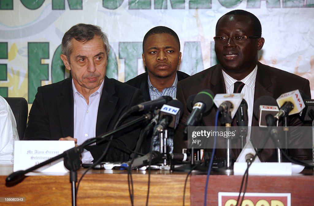 French former football international player Alain Giresse (L) gives gives a press conference with Senegalese football federation president Augustin Senghor (R), after signing to be the new coach of the Senegal national football team, on January 11, 2013 in Dakar. AFP PHOTO MAMADOU TOURE BEHAN
