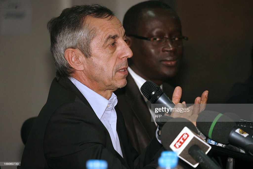 French former football international player Alain Giresse (L) speaks alongside Senegalese football federation president Augustin Senghor (R), after signing to be the new coach of the Senegal national football team, on January 11, 2013 in Dakar. AFP PHOTO / MAMADOU TOURE BEHAN