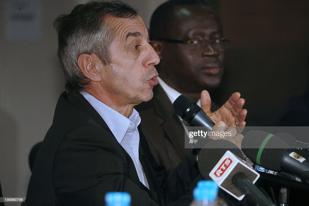 French former football international player Alain Giresse (L) speaks alongside Senegalese football federation president Augustin Senghor (R), after signing to be the new coach of the Senegal national football team, on January 11, 2013 in Dakar.