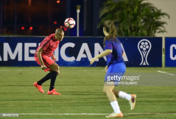 French former footballer David Trezeguet heads the ball during a friendly football match in Luque Paraguay on May 17 2017 in the framework of a...