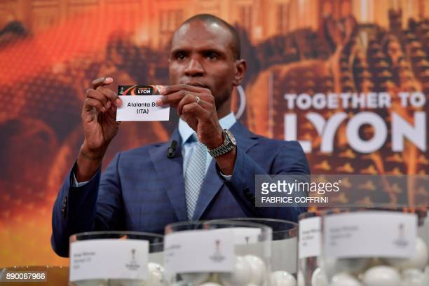 French former international Eric Abidal shows the slip of Atalanta Bergamo during the draw for the round of 32 of the UEFA Europa League football...