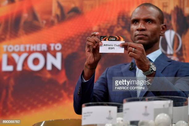French former international Eric Abidal shows the slip of Athletic Bilbao during the draw for the round of 32 of the UEFA Europa League football...