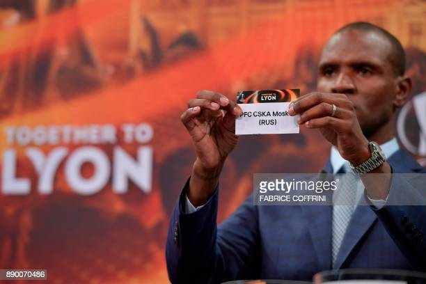 French former international Eric Abidal shows the slip of CSKA Moscow during the draw for the round of 32 of the UEFA Europa League football...