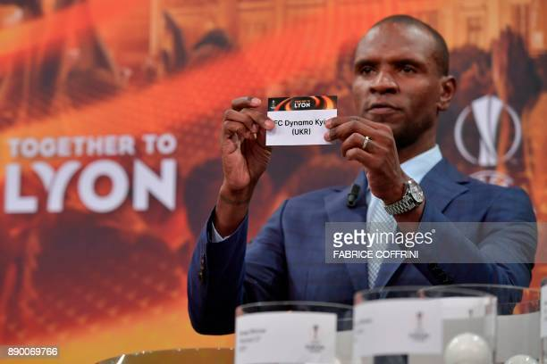 French former international Eric Abidal shows the slip of Dynamo Kiev during the draw for the round of 32 of the UEFA Europa League football...