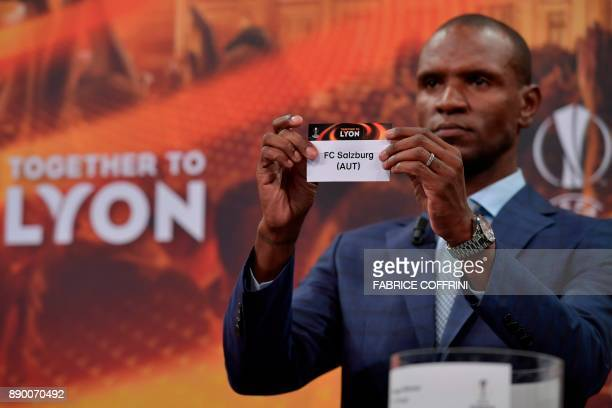 French former international Eric Abidal shows the slip of FC Salzburg during the draw for the round of 32 of the UEFA Europa League football...