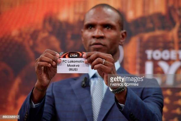 French former international Eric Abidal shows the slip of Lokomotiv Moscow during the draw for the round of 32 of the UEFA Europa League football...