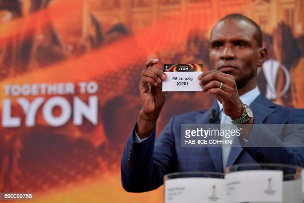 French former international Eric Abidal shows the slip of RB Leipzig during the draw for the round of 32 of the UEFA Europa League football...