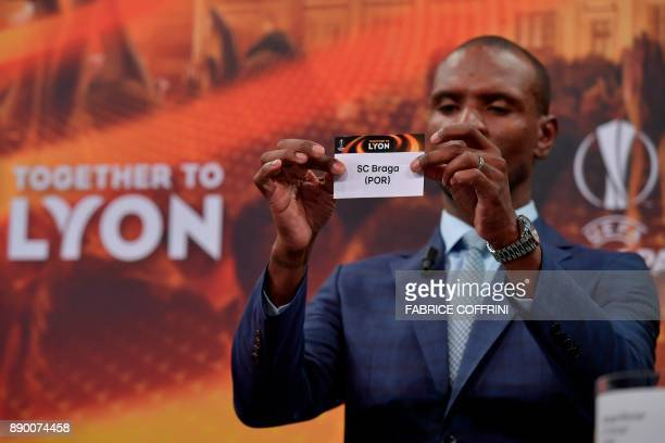 French former international Eric Abidal shows the slip of SC Braga during the draw for the round of 32 of the UEFA Europa League football tournament...