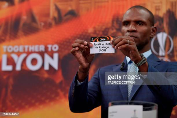 French former international Eric Abidal shows the slip of Sporting Lisbon during the draw for the round of 32 of the UEFA Europa League football...