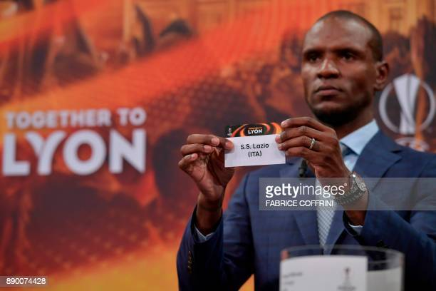 French former international Eric Abidal shows the slip of SS Lazio during the draw for the round of 32 of the UEFA Europa League football tournament...