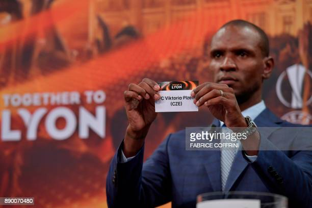 French former international Eric Abidal shows the slip of Viktoria Plzen during the draw for the round of 32 of the UEFA Europa League football...