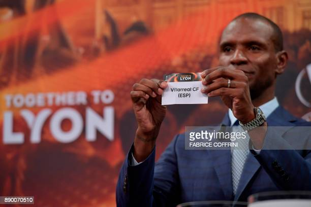 French former international Eric Abidal shows the slip of Villareal during the draw for the round of 32 of the UEFA Europa League football tournament...