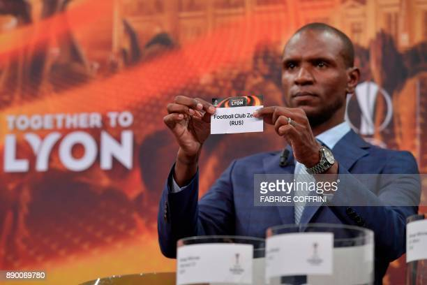 French former international Eric Abidal shows the slip of Zenit Moscow during the draw for the round of 32 of the UEFA Europa League football...
