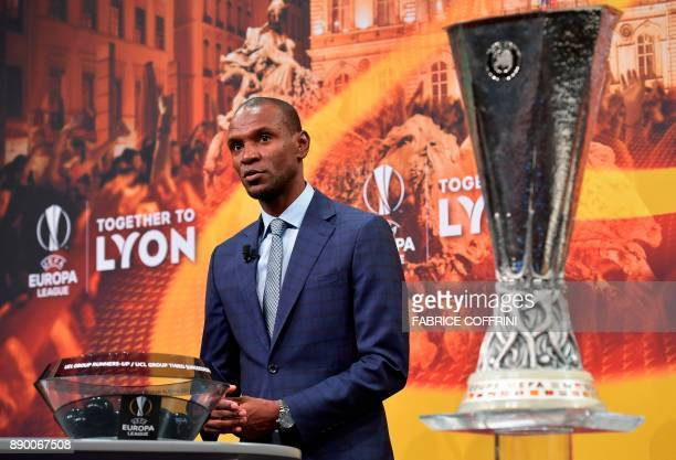 French former international Eric Abidal speaks flanked by the Champions League trophy ahead of draw for the round of 32 of the UEFA Europa League...