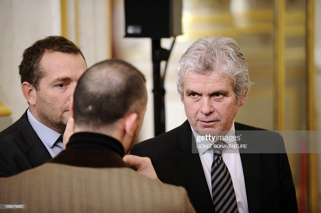 French former journalist and newly appointed French President's communication adviser, Claude Serillon (R) speaks with French President's press and communication adviser Christian Gravel (C) and Stephane Ruet (L), the Elysee's official photographer, on January 12, 2013 at the Elysee presidential palace in Paris.