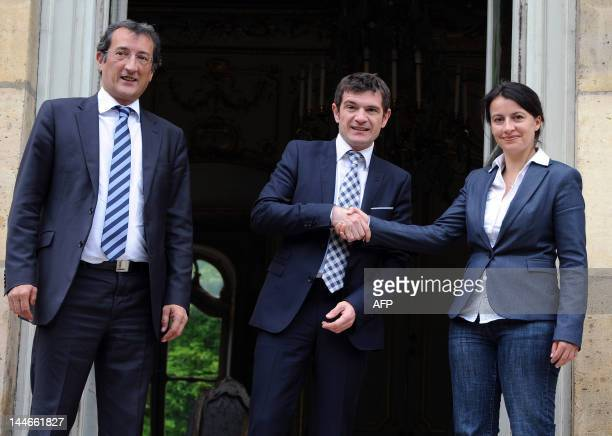 French former Junior Minister for Housing Benoist Apparu shakes hands with newlyappointed Minister for Equality of Territories and Housing Cecile...