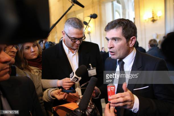 French former Minister Benoit Apparu speaks to journalists on November 21 2012 in Paris at the National Assembly as an ally of defeated candidate for...