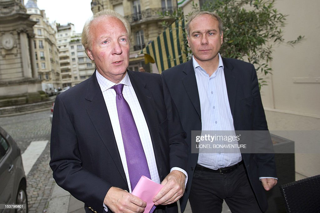 French former minister Brice Hortefeux (L) arrives to attend a breakfast gathering the members of the the association 'The friends of Nicolas Sarkozy', on October 9, 2012 in Paris.
