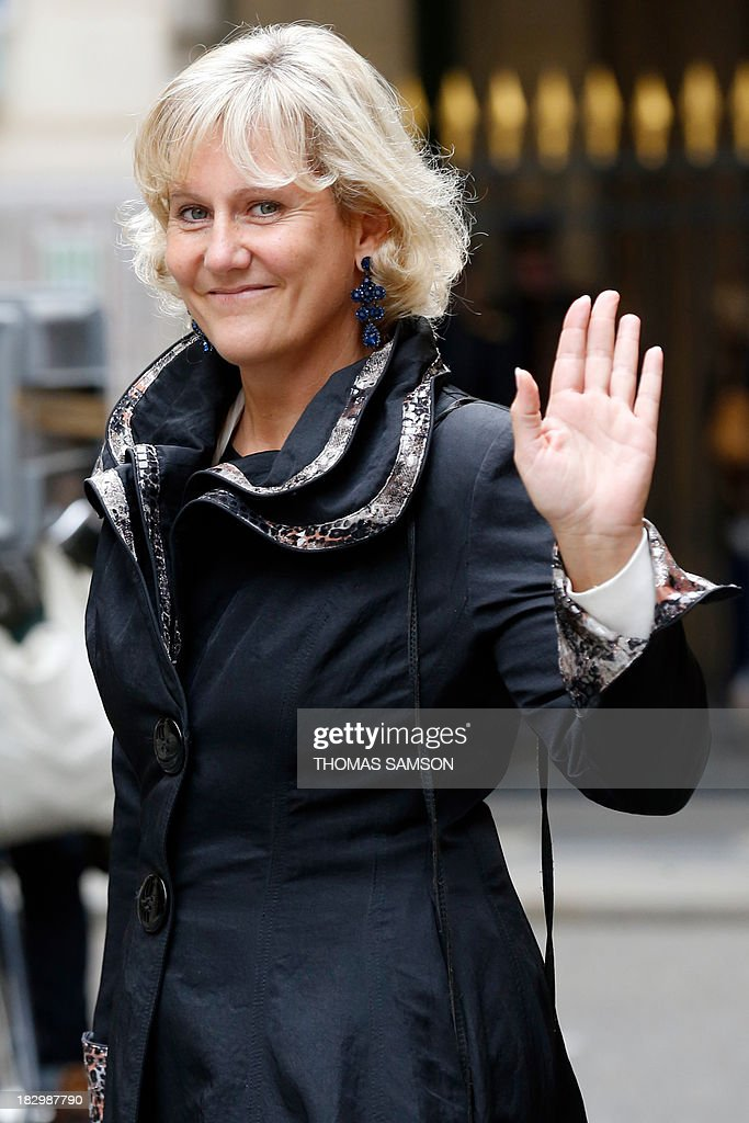 French former minister for Apprenticeship and Professional Formation Nadine Morano waves as she leaves the French Constitutional Council's headquarters on October 3, 2013, in Paris, after a ceremony celebrating the 55th anniversary of the French 5th Republic. Ministers of the French government and about 200 former ministers are expected to attend the ceremony celebrating the constitution written by Michel Debre especially for Charles de Gaulle in 1958 but still in force in 2013.