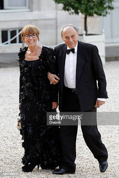 French former minister Michel Rocard and his wife arrive at the Elysee Palace for a State dinner in honor of Queen Elizabeth II hosted by French...