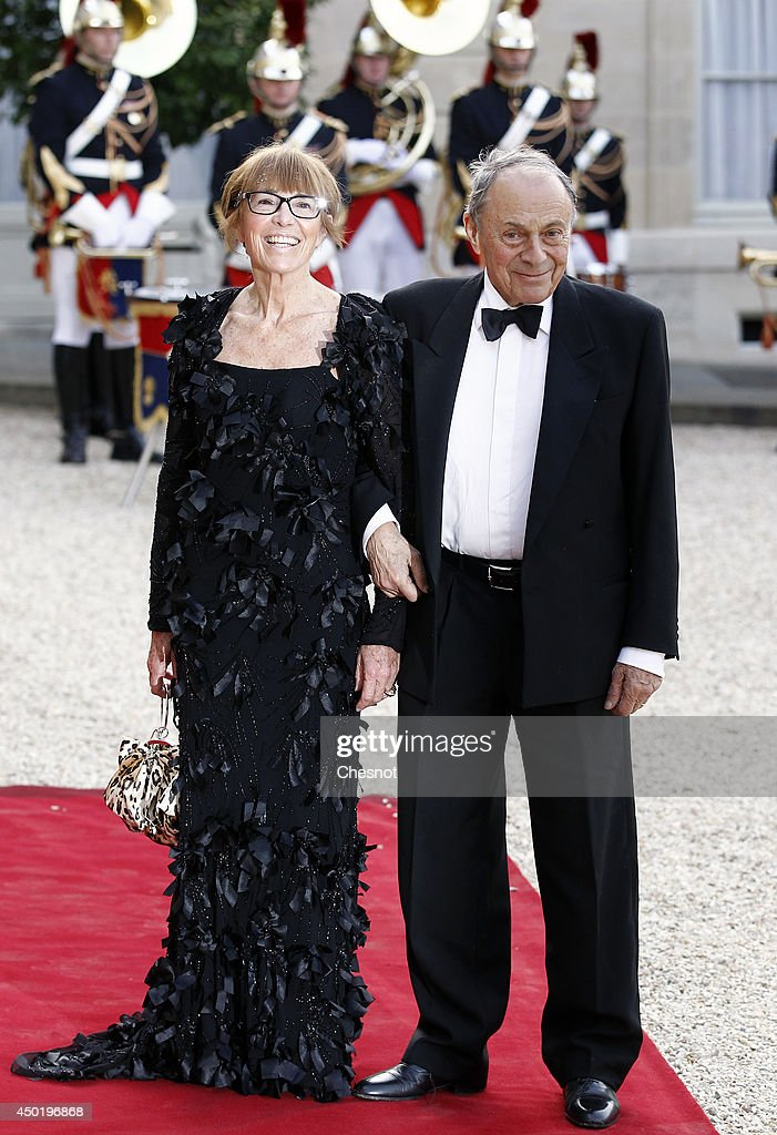 French former minister, <a gi-track='captionPersonalityLinkClicked' href=/galleries/search?phrase=Michel+Rocard&family=editorial&specificpeople=658761 ng-click='$event.stopPropagation()'>Michel Rocard</a> and his wife arrive at the Elysee Palace for a State dinner in honor of Queen Elizabeth II, hosted by French President Francois Hollande as part of a three days State visit of Queen Elizabeth II after the 70th Anniversary Of The D-Day on June 6, 2014 in Paris, France.