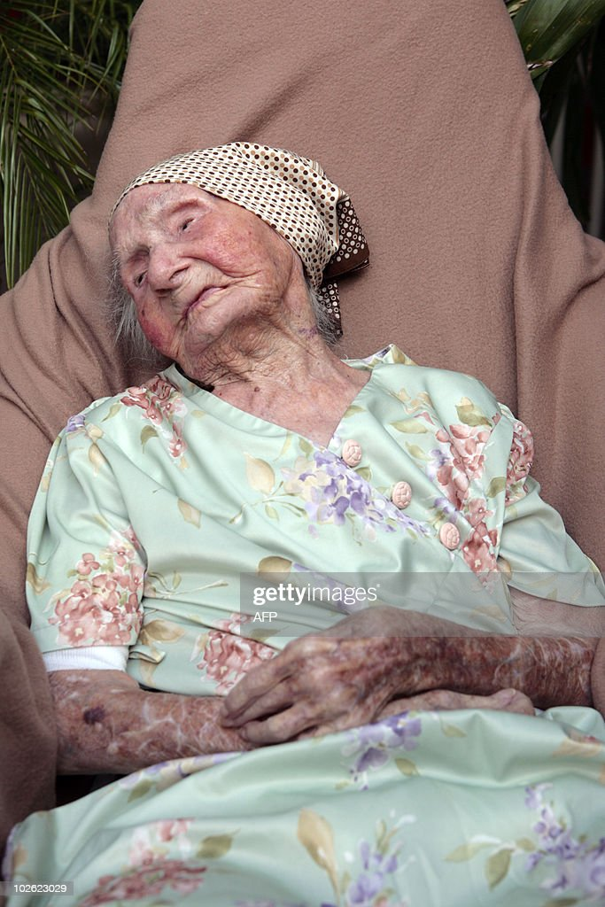 French former nun Eugenie Blanchard poses on May 10, 2010 at the hospital Bruyn in Gustavia, on the French overseas island of Saint-Barthelemy. Blanchard was born on February 16, 1896 in Saint-Barthelemy, and became the world's oldest person at the age of 114 after Japanese woman Kama Chinen died on May 2, 2010 aged 114 years 357 days, according to the Gerontology Research Group (GRG).