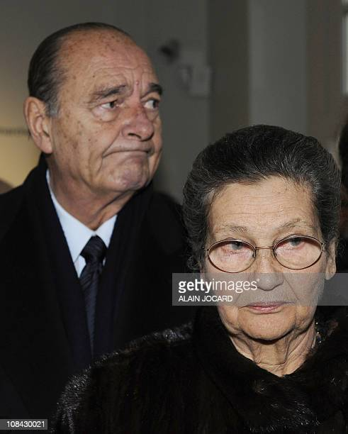 French former President Jacques Chirac and French former Minister Simone Veil former Auschwitz death camp's survivor attend on January 27 2011 in...