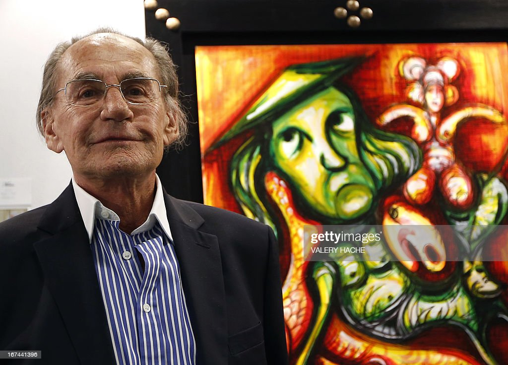 French former president's father, Pal Sarkozy poses in front of one of his artworks displayed during the 4th edition of the 'Art Monaco' contemporary art fair on April 25, 2013 in Monaco. The event takes place from April 25 to 28.
