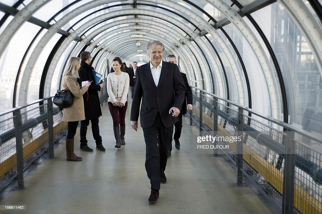 French former Prime minister Dominique de Villepin poses while visiting the Pompidou center on December 30, 2012 in Paris.