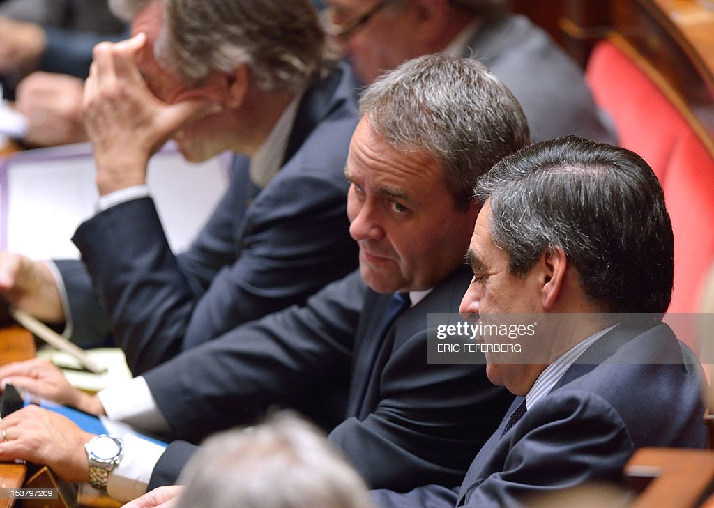 French former Prime minister Francois Fillon (R) chats with former minister Xavier Bertrand during the weekly session of the question to the government, on October 9, 2012 at the National Assembly in Paris.