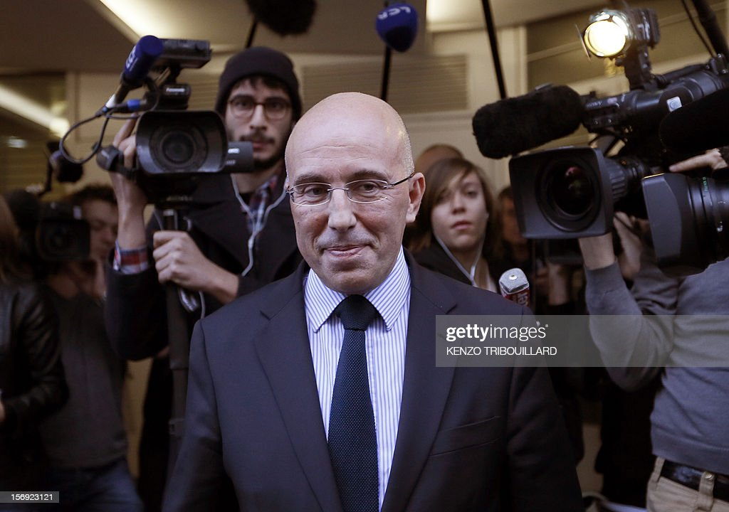 French former Prime minister Francois Fillon's campaign director, Eric Ciotti (C) reacts as he leaves the right-wing opposition UMP party's headquarters in Paris on November 25, 2012. Pro-Fillon supporter Ciotti slammed the door from the UMP's appeal elections control board, considering it illegitimate and biased. Party heavyweight Juppe, a former premier and foreign minister, will hold a mediation meeting later in the day with the right-winger, who was declared the winner of November 22 knife-edge vote to pick a party leader, Jean-Francois Cope, and his centrist rival Francois Fillon. The talks are to establish who actually won the leadership and whether mutual allegations of ballot rigging have any foundation.