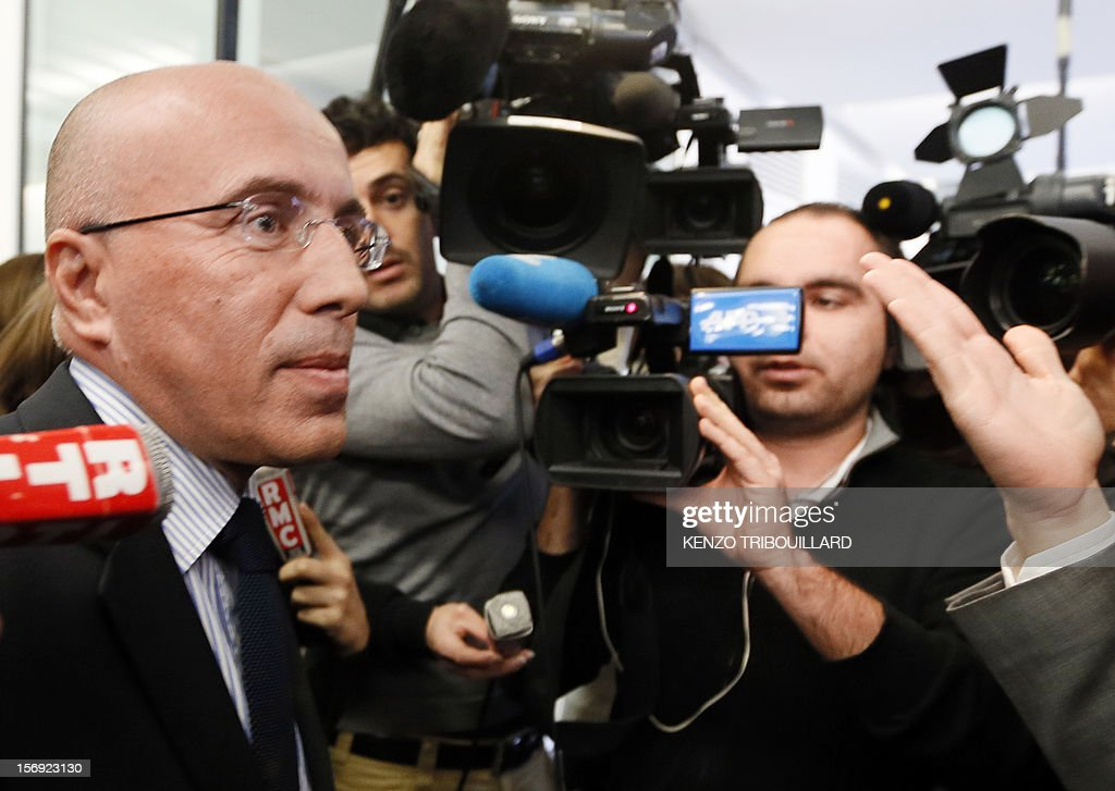 French former Prime minister Francois Fillon's campaign director, Eric Ciotti (L) answers the media as he leaves the right-wing opposition UMP party's headquarters in Paris on November 25, 2012. Pro-Fillon supporter Ciotti slammed the door from the UMP's appeal elections control board, considering it illegitimate and biased. Party heavyweight Juppe, a former premier and foreign minister, will hold a mediation meeting later in the day with the right-winger, who was declared the winner of November 22 knife-edge vote to pick a party leader, Jean-Francois Cope, and his centrist rival Francois Fillon. The talks are to establish who actually won the leadership and whether mutual allegations of ballot rigging have any foundation. AFP PHOTO KENZO TRIBOUILLARD