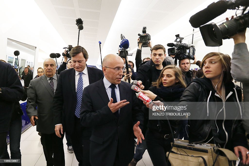 French former Prime minister Francois Fillon's campaign director, Eric Ciotti (C) answers the media at the right-wing opposition UMP party's headquarters in Paris on November 25, 2012. Pro-Fillon supporter Ciotti slammed the door from the UMP's appeal elections control board, considering it illegitimate and biased. Party heavyweight Juppe, a former premier and foreign minister, will hold a mediation meeting later in the day with the right-winger, who was declared the winner of November 22 knife-edge vote to pick a party leader, Jean-Francois Cope, and his centrist rival Francois Fillon. The talks are to establish who actually won the leadership and whether mutual allegations of ballot rigging have any foundation.
