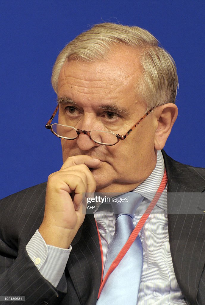 French former Prime Minister Jean-Pierre Raffarin listens to a speaker on June 16, 2010 in Paris during the symposium 'Europe/China: Facing our common challenges' organised in Paris by the French directorate-general of the Treasury.