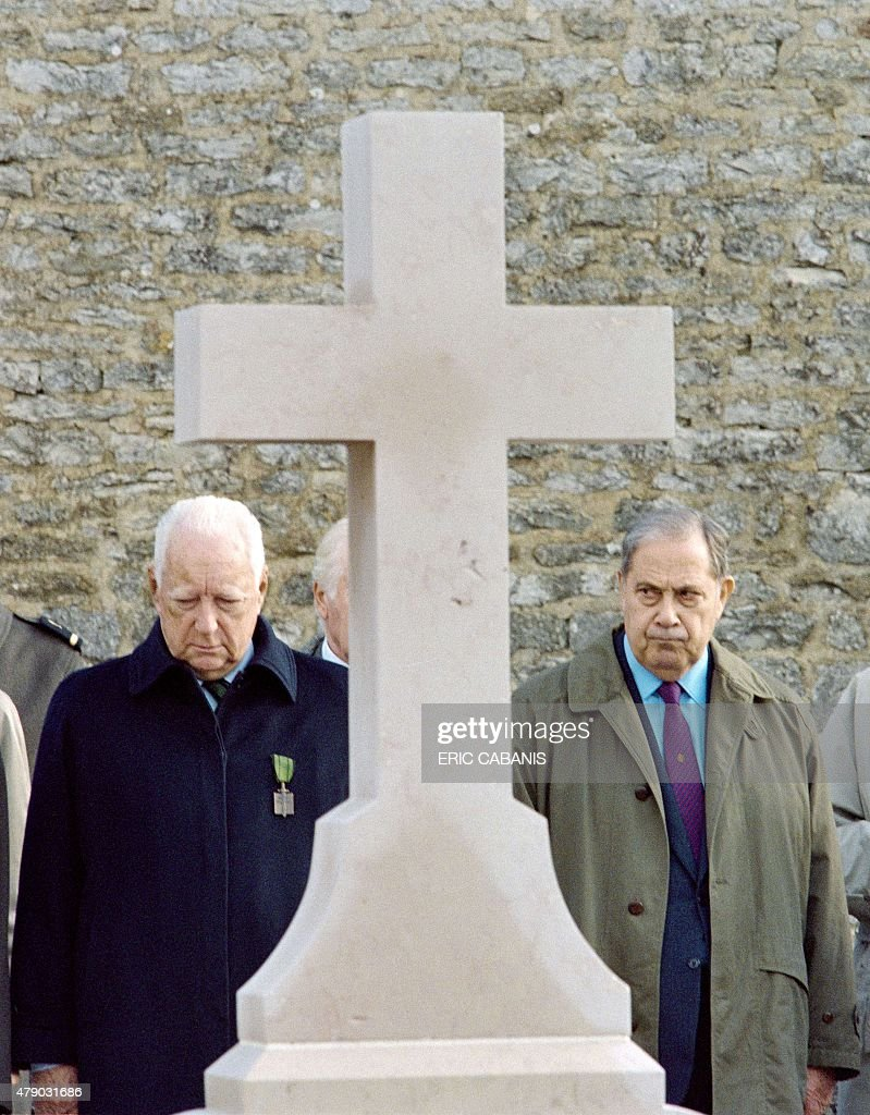 French former Prime minister Pierre Messmer (L) and former Interior minister <a gi-track='captionPersonalityLinkClicked' href=/galleries/search?phrase=Charles+Pasqua&family=editorial&specificpeople=701273 ng-click='$event.stopPropagation()'>Charles Pasqua</a> stand in front of the grave of late French president Charles de Gaulle, on November 9, 1996 in Colombey-les-Deux-Eglises. Former French interior minister <a gi-track='captionPersonalityLinkClicked' href=/galleries/search?phrase=Charles+Pasqua&family=editorial&specificpeople=701273 ng-click='$event.stopPropagation()'>Charles Pasqua</a>, a hardline politician who was a close ally of former president Jacques Chirac, died Monday aged 88, political sources said. Pasqua, a veteran of the Gaullist movement, spent more than half a century at the heart of French politics in a career punctuated by no-nonsense policies targeting terrorism but overshadowed by funding scandals. AFP PHOTO/ERIC CABANIS