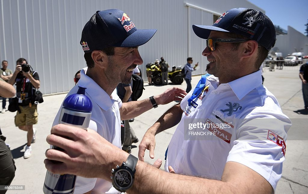 French former racing driver <a gi-track='captionPersonalityLinkClicked' href=/galleries/search?phrase=Luc+Alphand&family=editorial&specificpeople=697923 ng-click='$event.stopPropagation()'>Luc Alphand</a> (L) speaks with Peugeot's driver <a gi-track='captionPersonalityLinkClicked' href=/galleries/search?phrase=Cyril+Despres&family=editorial&specificpeople=2092881 ng-click='$event.stopPropagation()'>Cyril Despres</a> of France before a technical check-up in Buenos Aires, on January 2, 2015 ahead of the 2015 Dakar Rally which this year will thunder through Argentina, Bolivia and Chile from January 4 to 17.