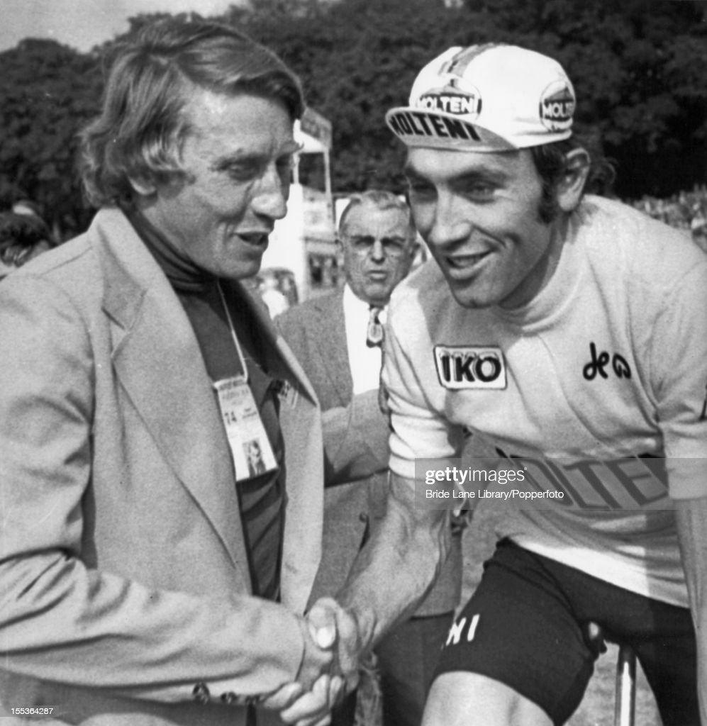 French former road racing cyclist Jacques Anquetil (1934 - 1987, left) shakes hands with race winner <a gi-track='captionPersonalityLinkClicked' href=/galleries/search?phrase=Eddy+Merckx&family=editorial&specificpeople=213957 ng-click='$event.stopPropagation()'>Eddy Merckx</a> of Belgium at the end of the Tour de France, Paris, 21st July 1974. Both men have now won the tour five times.
