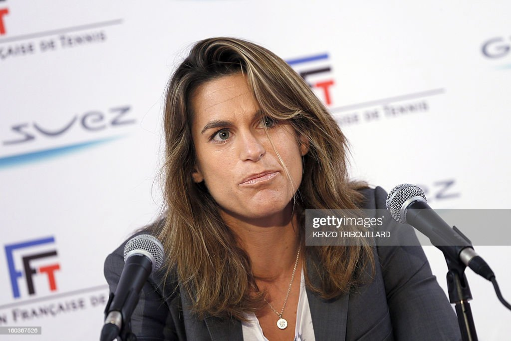 French former tennis player and French Fed Cup Tennis Captain, Amelie Mauresmo, gives a press conference on January 30, 2013 in Paris, during the 21st edition of the Paris WTA Open. Mauresmo announced that French Marion Bartoli, 28, was choosen for the next Fed Cup match against Germany in February. AFP PHOTO KENZO TRIBOUILLARD