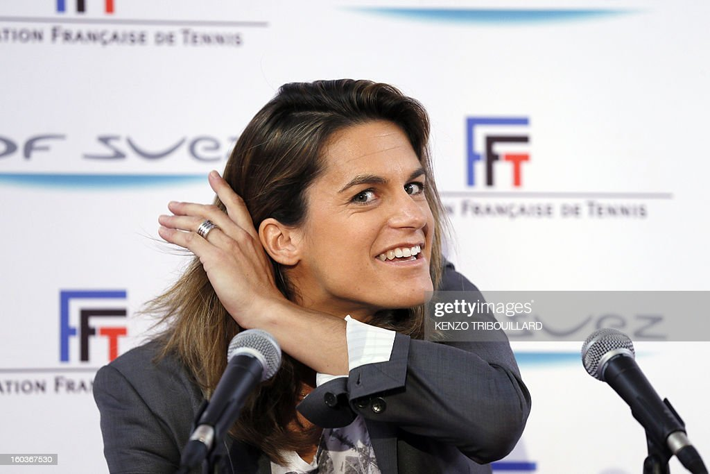 French former tennis player and French Fed Cup Tennis Captain, Amelie Mauresmo, gestures as she gives a press conference on January 30, 2013 in Paris, during the 21st edition of the Paris WTA Open. Mauresmo announced that French Marion Bartoli, 28, was choosen for the next Fed Cup match against Germany in February. AFP PHOTO KENZO TRIBOUILLARD