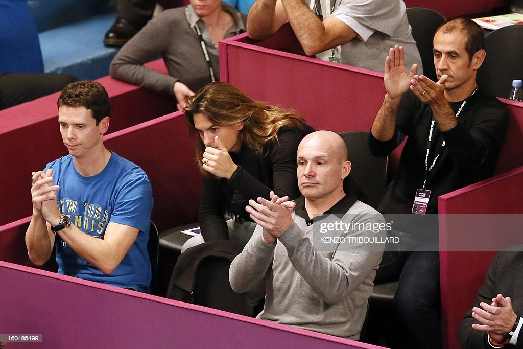 French former tennis player and French Fed Cup Tennis Captain, Amelie Mauresmo (C) encourages France's Marion Bartoli during the 21st edition of the Paris WTA Open on February 1, 2013.